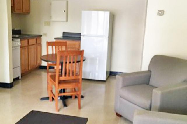 One-bedroom apartments feature a living room connected to a full kitchen and small dining area
