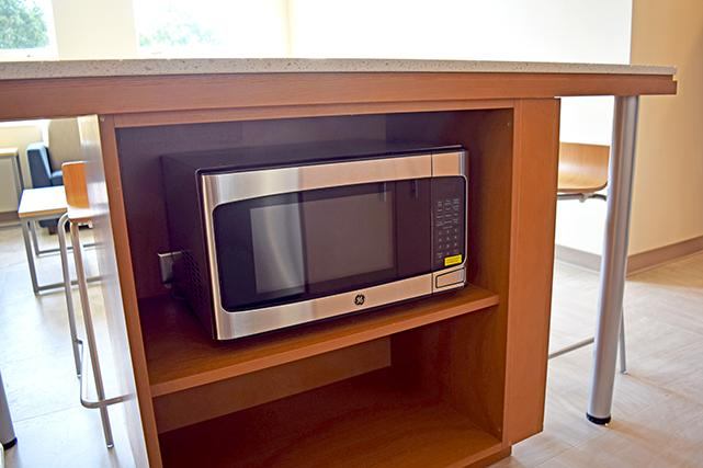 Kitchen islands include a microwave