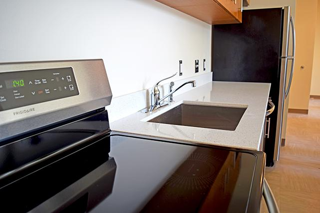 Kitchens include stoves with induction cooktops