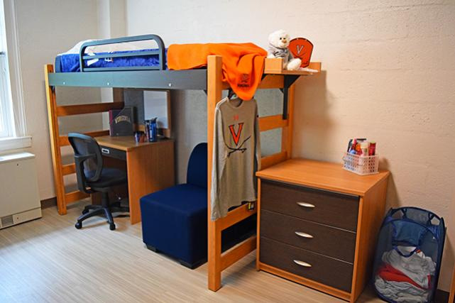 Renovated rooms include lofted beds, dressers, and desks
