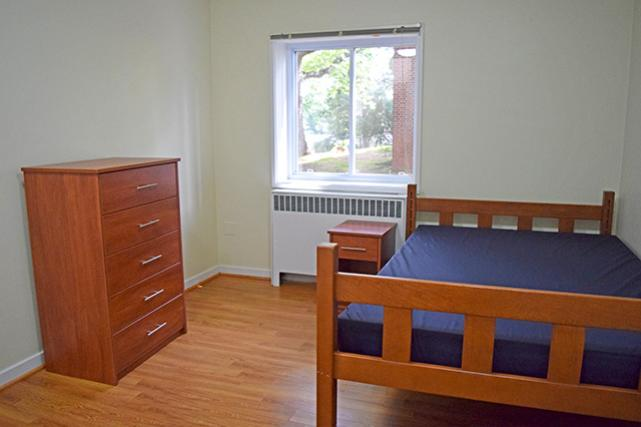 Furnished apartments include five-drawer dresser and nightstand