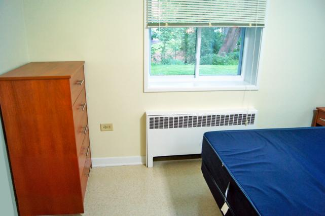 Double bed in furnished apartment