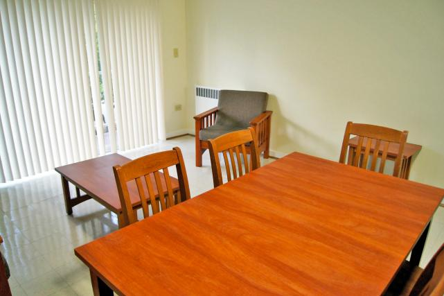Furnished apartments include a sofa, chair, end tables, and dining table and chairs