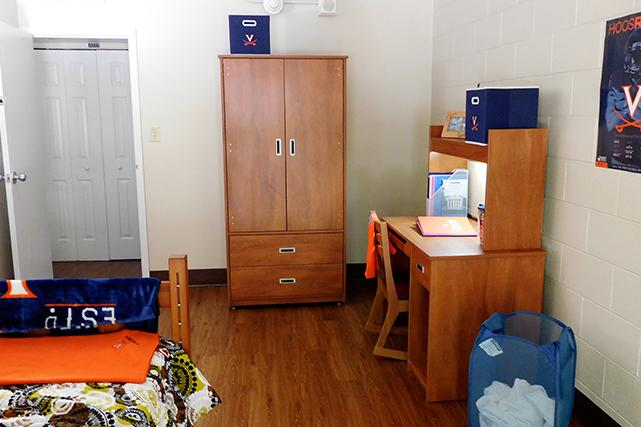 Bedrooms include desk, carrel, chair and wardrobe