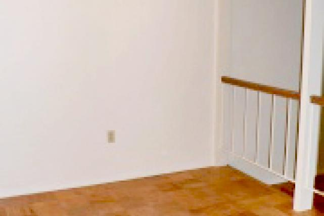 Dining room is adjacent to the kitchen (separated from the living room by a railing)