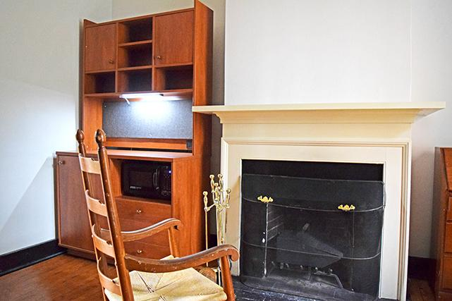 Fireplace and hutch in an empty Lawn room