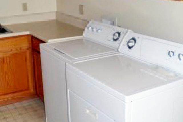 Kitchens have a washer and dryer as well as a built-in desk space