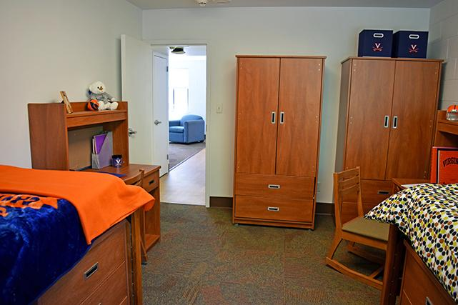 Bedrooms include desks, chairs, dressers, and wardrobes