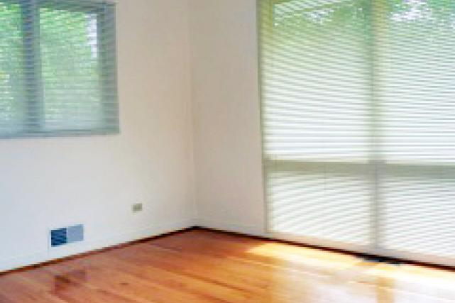 The master bedroom has picture windows and ample closet space