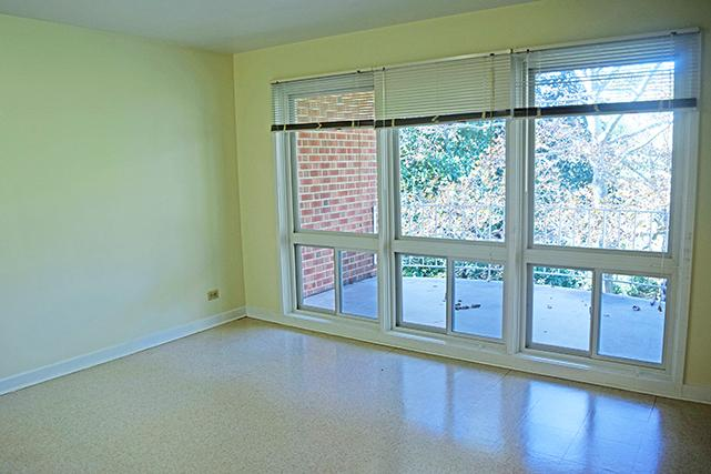 Two-bedroom apartment master bedrooms are bright, with picture windows overlooking the patio