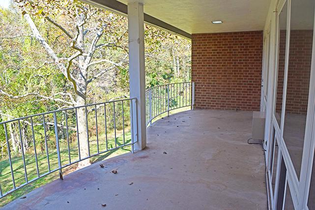 Two-bedroom apartments feature picture windows looking onto the private patio