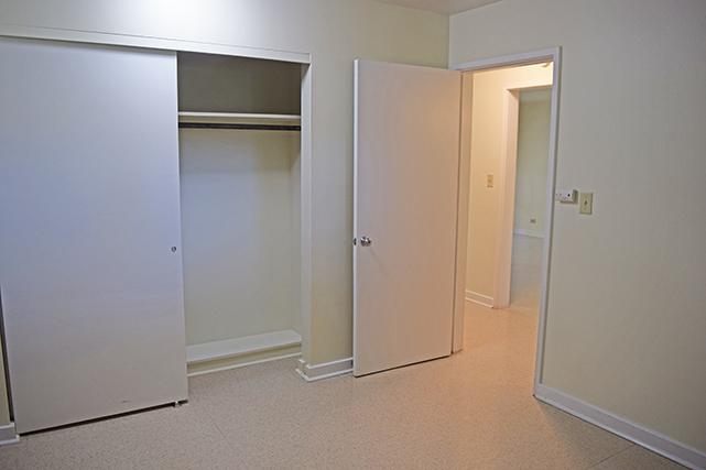 Two-bedroom apartments have double closets with sliding doors