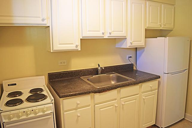 Two-bedroom apartment galley kitchens have ample counter and cabinet space