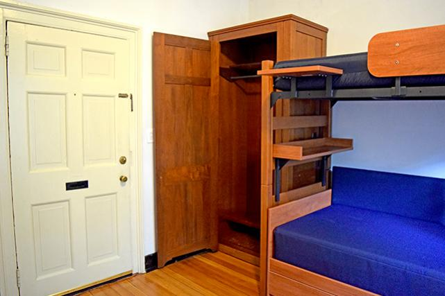 Bed and built-in wardrobe