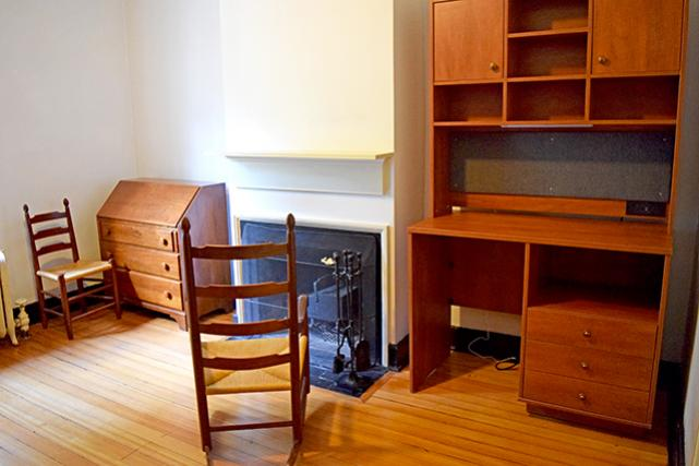Secretary desk, fireplace, and hutch (can accommodate a fridge and microwave)