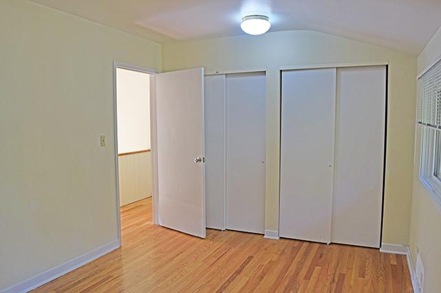 The master bedroom features two closets
