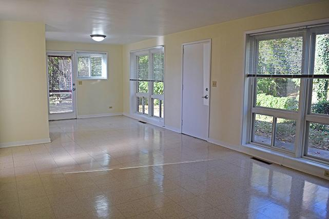 The living room and dining room are one spacious area on the lower level