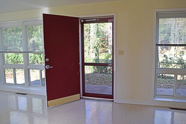 The lower level includes picture windows and a back door leading to an outdoor patio area