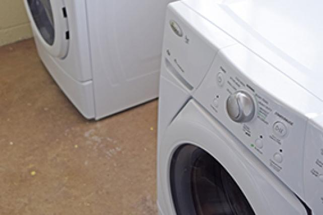 The lower level has a storage/laundry room with washer and dryer