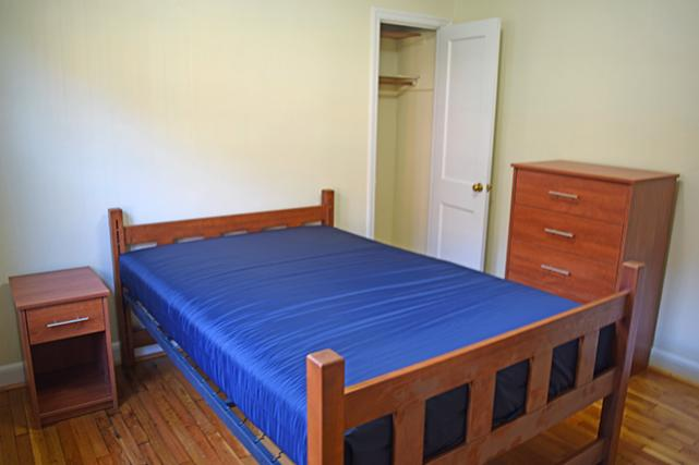 Furnished apartments include a 5-drawer dresser and nightstand in bedrooms with closets