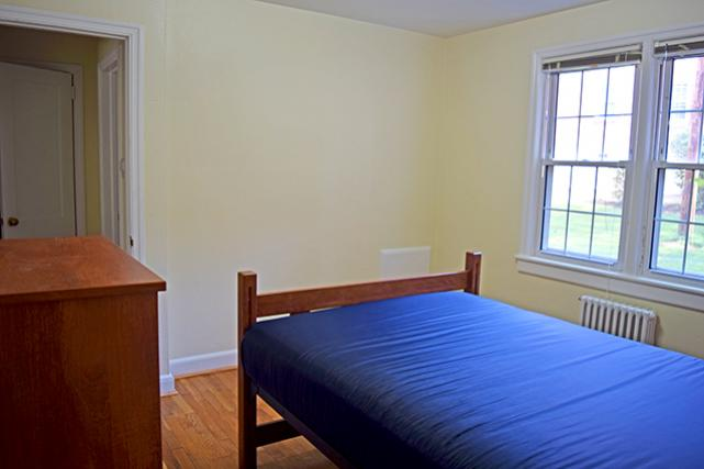 Furnished apartments include a 5-drawer dresser in bedroom with a double bed