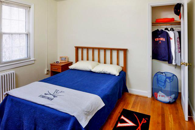 Double bed, nightstand, and closet in furnished apartment